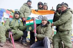 Members of the Expedition to Mt. Stok Kangri posing with National flag. -Excelsior/Stanzin