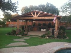 Traditional Outdoor Kitchen with rustic wood support columns