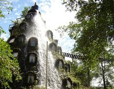 Hotel Montana Magica in Huilo Huilo, Chile: a man-made volcano hotel spits out water instead of lava. Amazing!