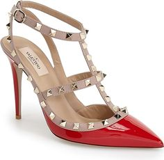 VALENTINO GARAVANI Women's Shoes in Red Patent Color. Signature pyramid studs trace the caged topline of a much-beloved pointy-toe pump crafted from high-shine patent leather. #VALENTINOGARAVANI #red #shoes #fashion #style