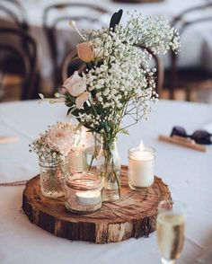 Rustic themed weddings are still super charming and relaxed! #RusticWeddings #RusticCenterpiece #BabysBreath #WhiteCandles