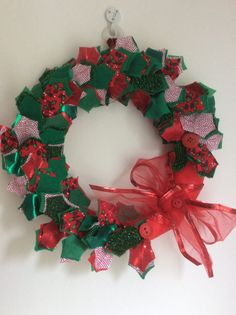Christmas wreath with fabric leaves and wrapped with wired edged organza ribbon, indoor use.