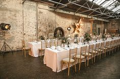 Photo Credit: Kat Hill | Cosy Romantic Urban Winter Warehouse Wedding | Planning and Styling by London Bride | Flowers by Grace and Thorn | Venue MC Motors