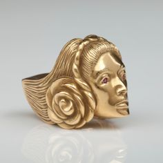 Gold self-portrait ring by Marisol Escobar