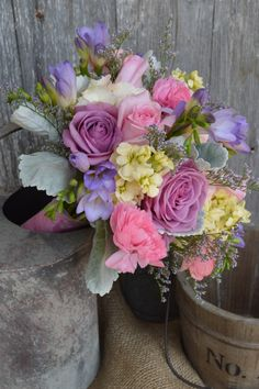 Pastel pinks lavenders and blues Bridal Bouquet with hydrangea, roses, peony and dusty miller by Twig Floral Designs, Carbondale, Illinois www.twig-designs.com Jonathan Reiman Designer.