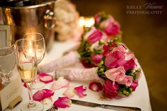 different shades of pink roses in the bridesmaids bouquets