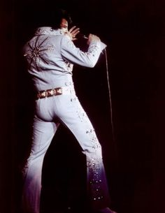 Elvis singing his heart out. Honourable mention must go to his hot and incredibly sexy backside. It's so firm oh my lord it's gorgeous