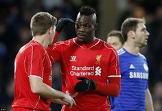 Mario Balotelli chats with Liverpool captain Steven Gerrard after coming on as a substitute on Tuesday