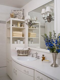 Don't Cut Corners~        Make use of awkward angles by filling them with corner shelf units. Here, a corner cabinet sits on the countertop, making the most out of a problematic space. Also, consider open shelves, which help your bathroom look more spacious.