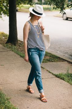a loose striped tank, boyfriend jeans and simple sandals.