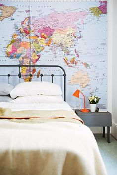 A map wall. Cool idea for kids' room. Maybe they'll learn geography by osmosis. :)