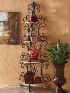 This eye-catching display has richly finished wooden shelves and a scrolled metal frame that creates a stunning focal point. Some assembly required. 4 Shelf Bookcase, Tuscan Style Homes, Metal Bending, Shelf Furniture, Wrought Iron Gates, Old World Style, Wooden Shelves, Creative Home, Interior Design Living Room