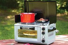 Coleman Oven / Stove I didn't even know these existed....pretty sure I NEED one of these now!!