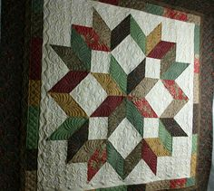 Beautiful quilting on this Carpenter's Star