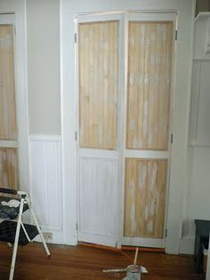 Turned louvered bi-fold doors in to something more classy with snap-together wood planks, or wood pieces in general!