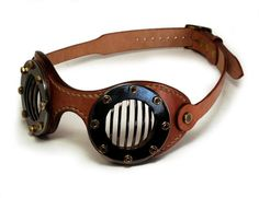 You are looking at a premium pair of Steampunk goggles. The FLAT design was born so to have the lowest frames possible, the lightest build and the most comfortable fit we could achieve by now. These will fit into the palm of your hand or your pocket. At the same time, providing double protection for your eyes area, meaning the lenses plus the mild steel bars. This time we wanted to make goggles that will be a bit more practical and casual, if you will. With a wider field of view, minimized…