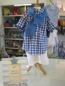 Adorable blue and white checked shirt and white shorts for baby boy.