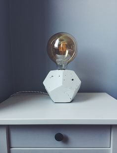 Pentagon shaped handmade concrete lamp.
