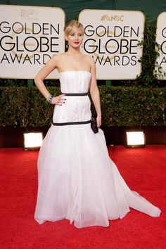 Vogue - Special Edition Best Dressed: The 2014 Golden Globe Awards - edited by Chloe Malle - Jennifer Lawrence in a Christian Dior Haute Couture dress and Roger Vivier bag