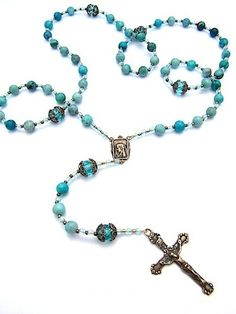 So I want a rosary tattoo, but the larger beads I want to be forget-me-not flowers