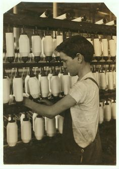 King Philip - Mule Spinning Room. Back boy - Roving. Charles Cavanagh, 863 Slade St.15 years.] Location: Fall River, Massachusetts.