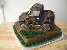 Truck Mudding cake - Truck was made out of cake and fondant.  The mud is choc icing.  One of my best friends sons loves 4x4 mud bogging so I made this cake for him!