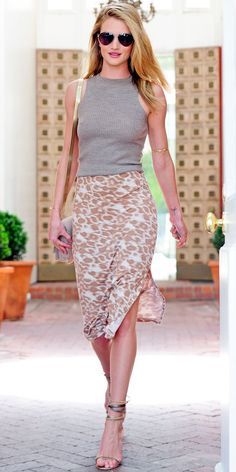 04/14/13: Rosie Huntington-Whiteley exited her hair salon in a cool pairing of a ribbed tank, printed pencil skirt, gold jewels and twisted sandals. #lookoftheday