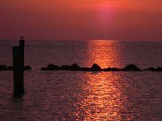 Alba a Lido di Dante a Ravenna,  la calma e la bellezza del mare Adriatico