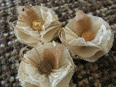 Burlap rosettes with decorative jewels. #RusticChicDecorations