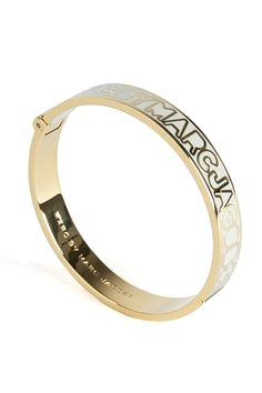 Skinny hinge bangle featuring a pop of cream colour with the signature Marc By Marc Jacobs logo. #Marcbymarcjacobs