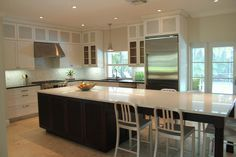 Aesthetic Island Table home remodel Contemporary Kitchen Miami home loans back splash tile bar stools breakfast bar ceiling lighting crown molding eat in kitchen french doors kitchen island large island louver cabinets mosaic tile pendant lighting recessed lighting stainless steel appliances travertine flooring two tone cabinets utility pendants white cabinets white kitchen - Decorcology.com