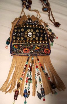Add some strands of beads to fringe things. Would be cute to do turquoise and coral...