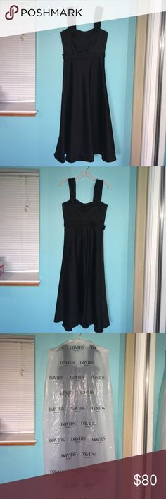 David's Bridal black wide strap tea length dress This a BRAND NEW black tea length, size 2, 100% polyester bridesmaid dress that I purchased at my local davids bridal just a few days ago for a dance. It was a final purchase and I decided on wearing a different dress to the dance in the end, so this has never been worn! (Besides when I tried it on in the store). I took off the tag because I thought I was going to wear it to the dance but I still have the receipt to prove it's genuinely new. I…