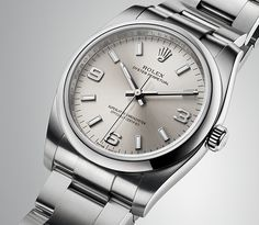 A Rolex Oyster Perpetual 34 with silver dial, combining 18ct white gold arabic numerals with indices filled with luminescent material for high legibility in low-light conditions.