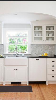herringbone backsplash, farmhouse sink, rustic drawer pulls, glass on upper cabinets