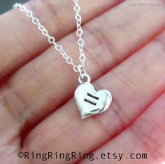 Love is equal. Equal Love Heart necklace, sterling silver. Length adjustable. Show your support for gay and lesbian marriage and equal rights. Handmade by RingRingRing on Etsy.
