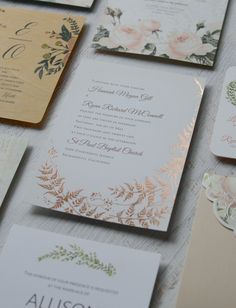 A wedding invitation featuring rose gold ferns. Elegant, rustic, romantic.
