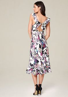 Pretty satin midi dress finished with sweet ruffle straps and hem. Sexy open-back design. Back neck box-clasp closure. Hidden back hook-and-eye and zip closure.