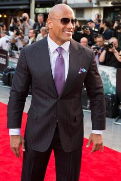 The infamous San Andreas Fault finally gives, triggering a magnitude 9 earthquake in California. Find the latest San Andreas news & Info at Warner Bros. The Rock Dwayne Johnson, Rock Johnson, Dwayne The Rock, Men's Business Outfits, Bald Men, Bae, San Andreas, Sharp Dressed Man, Star Wars