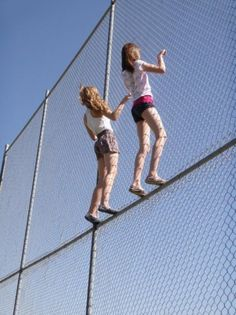Climbing a fence to see a game #sportsgirl #summer #rebel
