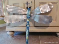 Dragonfly sculpture: old table leg body and corrugated roofing wings