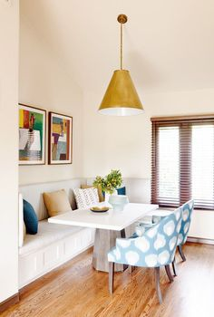 Cozy breakfast nook with gold and navy accents