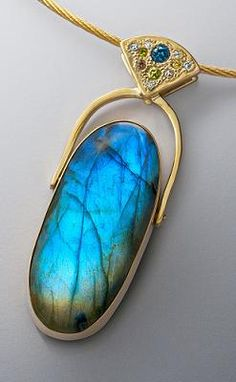 jewelry image of Large 14K pendant with 48ct Labradorite and.51ct. fancy colored diamonds set pave' style.