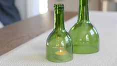 Few upcycling ideas for glass bottles that are both stylish and environmentally . Few upcycling ideas for glass bottles that are both stylish and environmentally friendly. Reuse Wine Bottles, Wine Bottle Candles, Recycled Glass Bottles, Glass Bottle Crafts, Diy Bottle, Bottle Art, Diy Projects With Glass Bottles, Melted Wine Bottles, Empty Bottles