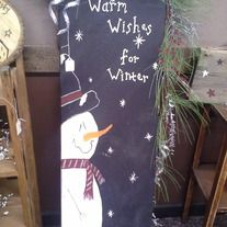 "Hand painted snowman ironing board with winter garland.  ""Warm wishes for Winter""?  Stands about 47"" tall with garland."