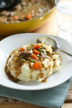 Irish Beef Stew & Mashed Potatoes ... mmm this may be the one! Never thought of serving over potatoes! Yum