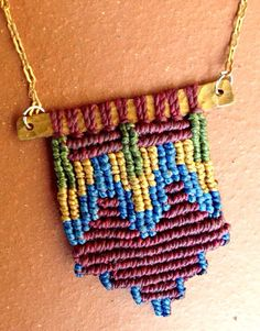 Colorful Fiber and Brass Macrame Pendant by mioteo on Etsy.