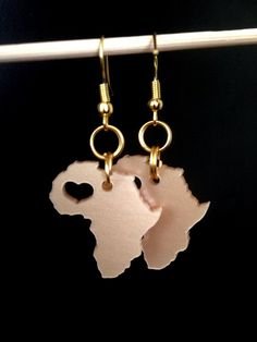 #Africa shaped earrings (Acrylic gold) via HouseofChi. Click on the image to see more!