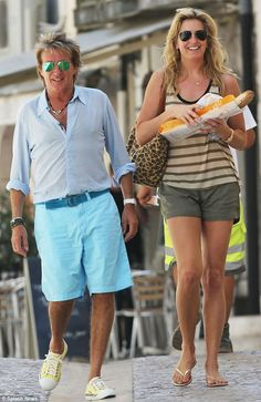You wear it well: Rod Stewart sports florescent blue shorts as he picks up baguettes and croissants in the South of France with wife Penny Lancaster