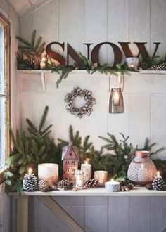 Cozy Pine and Candle Snow Display